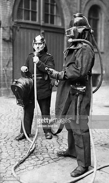 German Empire Free State Prussia Brandenburg Province Berlin Fire brigade with new equipment Fireman with a modern smoke helmet Photographer Willi...