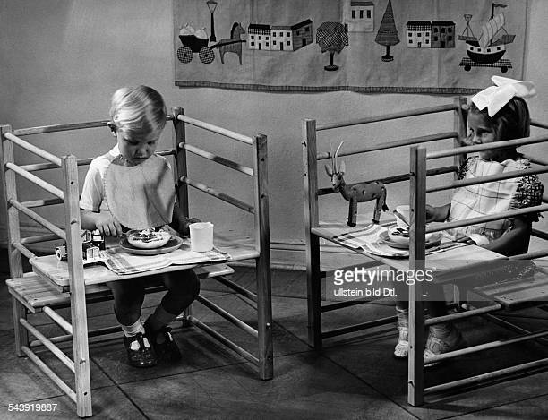 German Empire Free State Prussia Brandenburg Province Berlin Girl and boy eating on special constructed tables Photographer Peter Weller Published by...