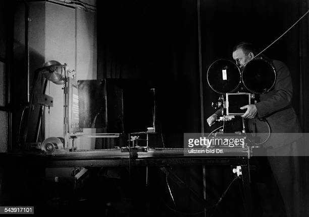 German Empire Free State Prussia Brandenburg Province Berlin Production of the German newsreel ' Wochenschau ' for German Cinemas man is filming...