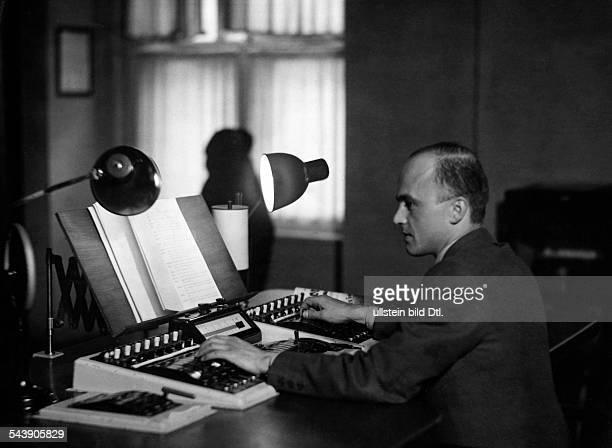 German Empire Free State Prussia Brandenburg Province Berlin Radio station ' Reichssender Berlin ' Sound engineer at work Photographer Curt Ullmann...