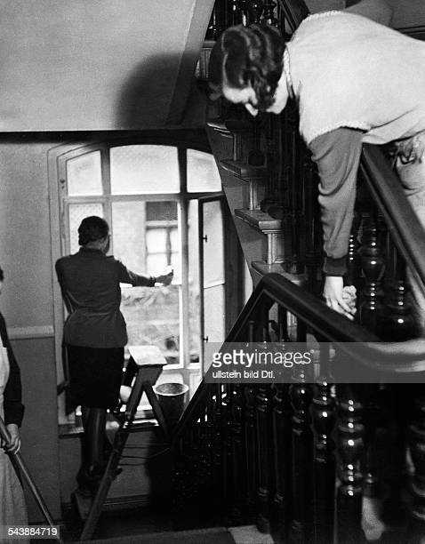 German Empire Free State Prussia Brandenburg Province Berlin Women doing housework cleaning the windows in the staircase Photographer Curt Ullmann...