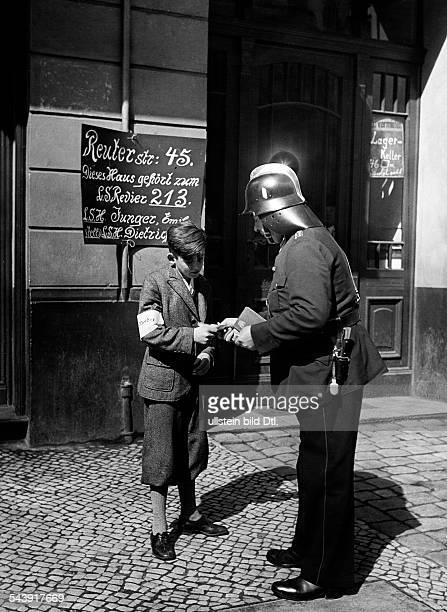 German Empire Free State Prussia Brandenburg Provinz Berlin Air raid drill ' Grosse Berliner Luftschutzuebung ' young boy is bringing some news for a...