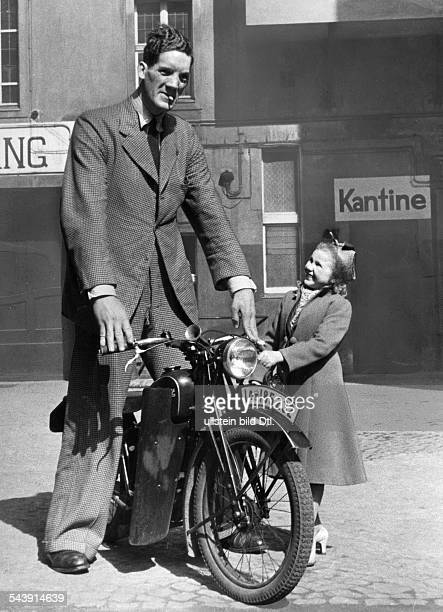 German Empire Free State Prussia Brandenburg Provinz Berlin Scottish giant on a motorbike next to him a young girl Photographer Heinz Fremke...