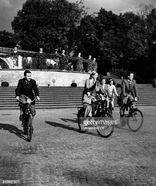 German Empire Free State Prussia Brandenburg Provinz Potsdam cyclists in front of the Orangery in the palace garden of 'Sanssouci' Photographer...
