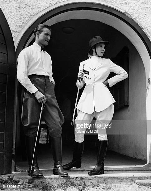 German Empire Free State Prussia Man and woman in horse riding clothes she is wearing white breeches and a waisted silk jacket design Hoffmann...