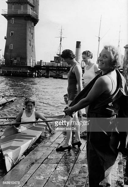 German Empire Free State Prussia Schleswig-Holstein Province Kiel: Women starting to canoe after a civil defense exercise in the port - Photographer:...