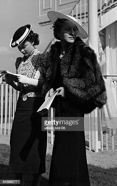 German Empire Horse racing at the race track in Iffezheim in BadenBaden two women with hats at the races in BadenBaden Photographer Max Ehlert...