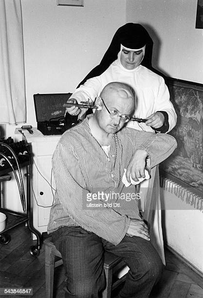 German Empire Kingdom Bavaria Munich Hospital and home for wounded soldiers with brain injuries nurse preparing treatment with electricity to ease...