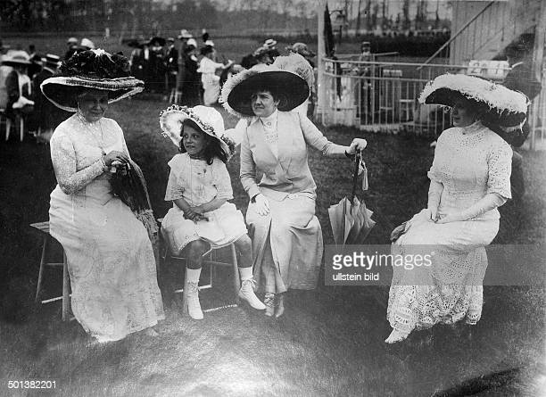 German Empire Kingdom Prussia Berlin Berlin Horse race Scene from the Grand Army Steeplechase at the Grunewald Race Course female specators with a...