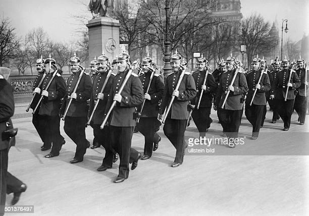 Fire brigade marching on a bridge In the background Berlin Dome Photographer Haeckel