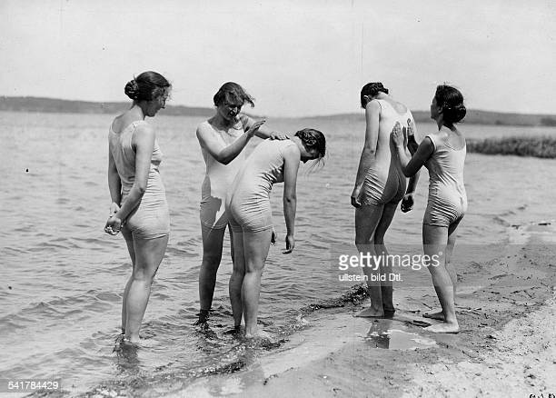 German Empire Kingdom Prussia Gymnastics at the beachYoung women doing some limberingup exercise Published by Blatt 21/1927Vintage property of...