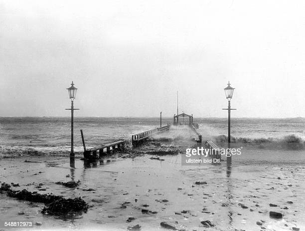 German Empire Kingdom Prussia SchleswigHolstein Province Helgoland Thunderstorm at the North Sea the submerged gangplank during a storm surge 1898...
