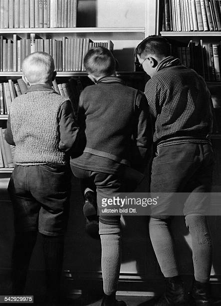German Empire Reading room for children in the library in Adalbertsrasse in Berlin Kreuzberg boys at the bookshelf Published in Bazar...