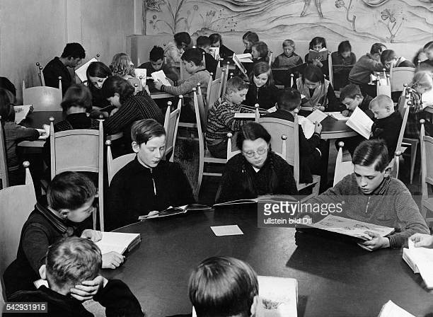 German Empire Reading room for children in the library in Adalbertsrasse in Berlin Kreuzberg children reading Published in Bazar 4/1935Photographer...