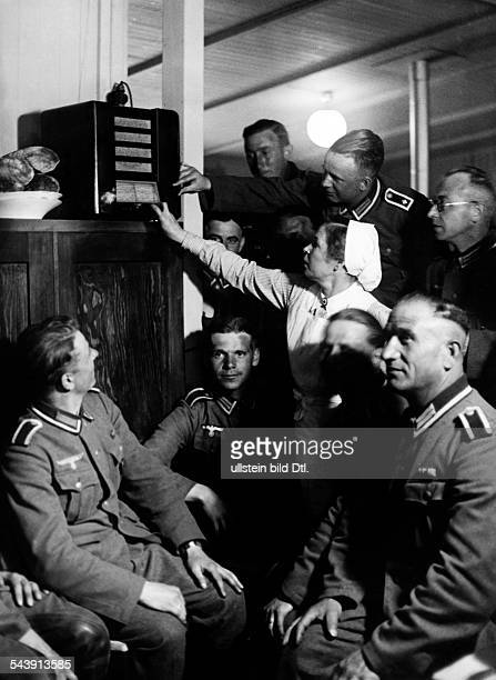 German Empire Saxony Kingdom Leipzig A break at the front sodiers and a woman of the Red Cross listen to the radio Photographer Curt Ullmann...