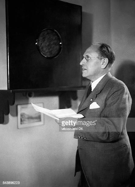 German Empire Saxony Kingdom Leipzig Radio station ' Reichssender Dresden ' Director Emil Eugen Hohrath is listening to a broadcast Photographer Curt...