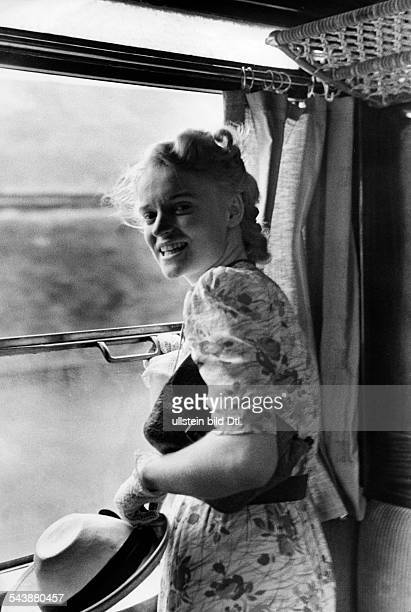 German Empire : Young woman standing at the open window in a train cabin - Photographer: Paul Mai- undatedVintage property of ullstein bild
