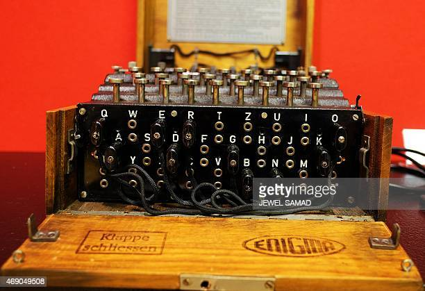 A German Enigma machine is displayed at the Bonhams during a press preview in New York on April 9 2015 The machine is part of an upcoming auction...