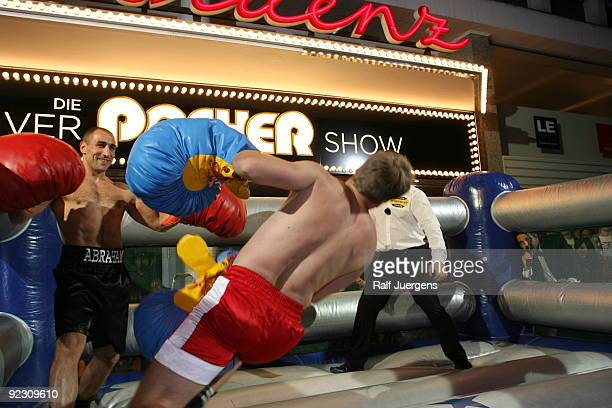 German entertainer Oliver Pocher and German boxer Arthur Abraham fight during a taping for 'Die Oliver Pocher Show' television show on October 23...