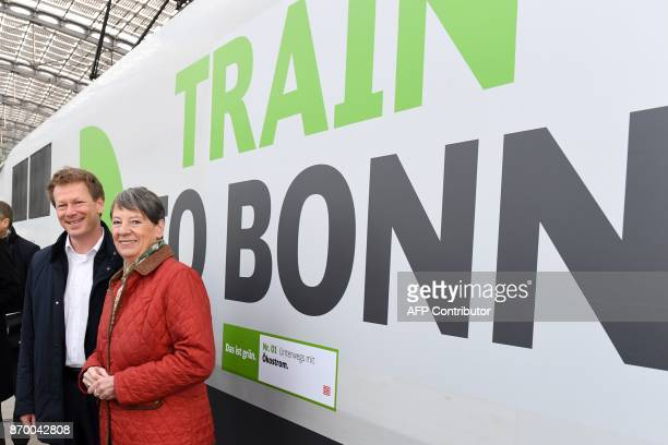 German Environment Minister Barbara Hendricks and Richard Lutz chairman of German railway operator Deutsche Bahn pose in front of a special ICE high...