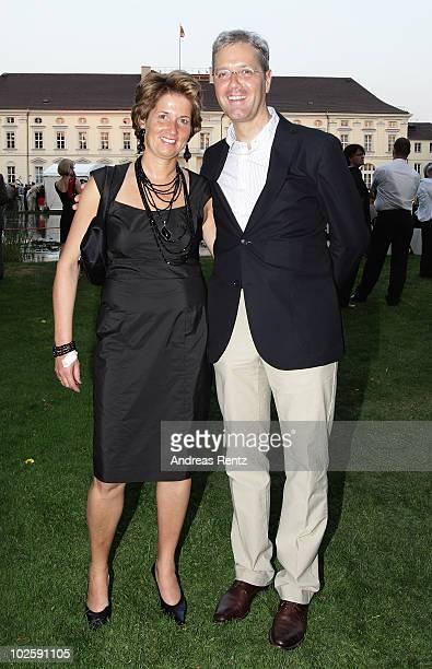 German Environment Minister Norbert Roettgen and his wife Ebba HerfsRoettgen attend at the President's annual summer garden party at Schloss Bellevue...