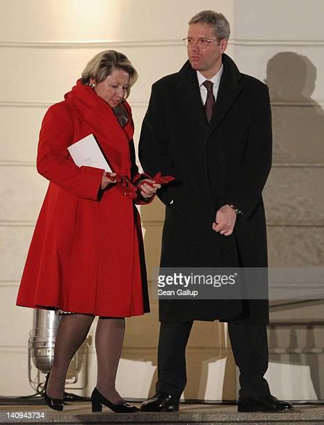 German Environment Minister Norbert Roettgen and his wife Ebba HerfsRoettgen attend the Zapfenstreich or taps farewell ceremony for former German...