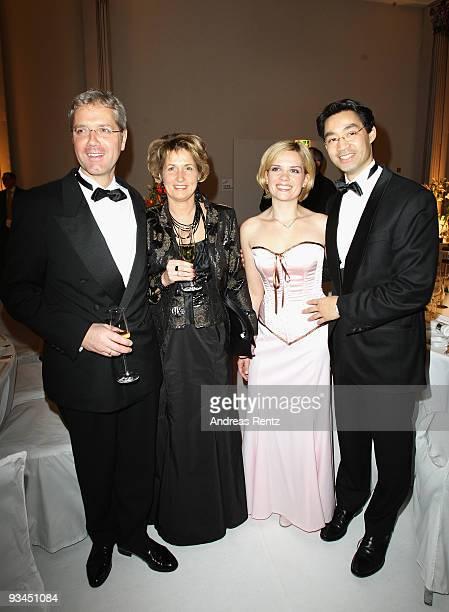 German Environment Minister Norbert Roettgen with his wife Ebba HerfsRoettgen and German Health Minister Philipp Roesler with his wife Wiebke Roesler...
