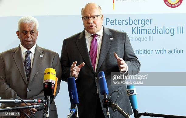 German environment minister Peter Altmaier and Abdullah bin Hamad AlAttiyah deputy prime minister of Qatar address the press at the beginning of the...