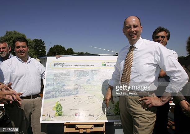 German Environment Minister Sigmar Gabriel and German Transport Minister Wolfgang Tiefensee stand beside chart with information on nature...