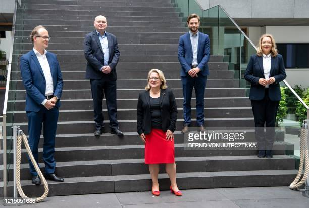 German Environment Minister Svenja Schulze poses on the sidelines of a press conference on May 25 2020 in Berlin with Sebastian Dullien from the...