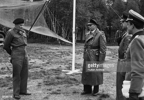 German envoy of Admiral HansGeorg von Friedeburg General Eberhard Kinzel and General Ernst Busch meeting with Field Marshall Bernard L Montgomery...