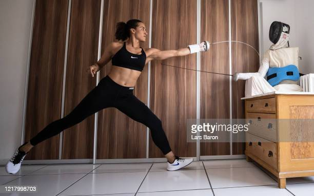 German epee fencer Alexandra Ndolo trains with a self made puppet in her apartment on April 09 2020 in Cologne Germany Ndolo normally trains with a...