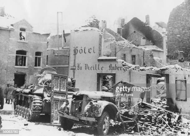 German equipment abandoned in the snow in the Belgian town of Houffalize, shortly after a period of intense bombardment, January 1945.