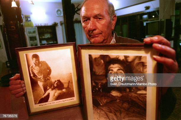 VALLEGRANDE BOLIVIA SEPTEMBER 10 2004 German Erich Bloessl shows his pictures September 10 2004 of the dead Che Guevara in the laundry of the Senor...