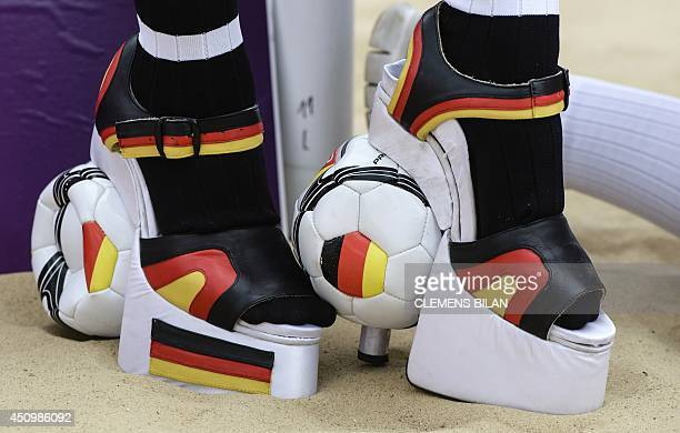 German erotic model Micaela Schaefer poses with football styled high heels featuring the German national colours during a promotional event called...