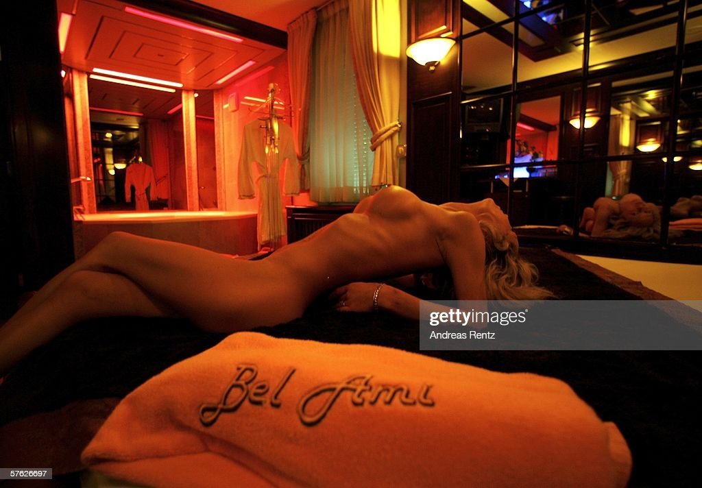 German escort Jaqueline awaits customers at Berlin's exclusive Night Club Bel Ami on May 16, 2006 in Berlin, Germany. Escort girls across Germany are anticipating booming business in June as soccer fans from around the world will descend upon the country for the World Cup.