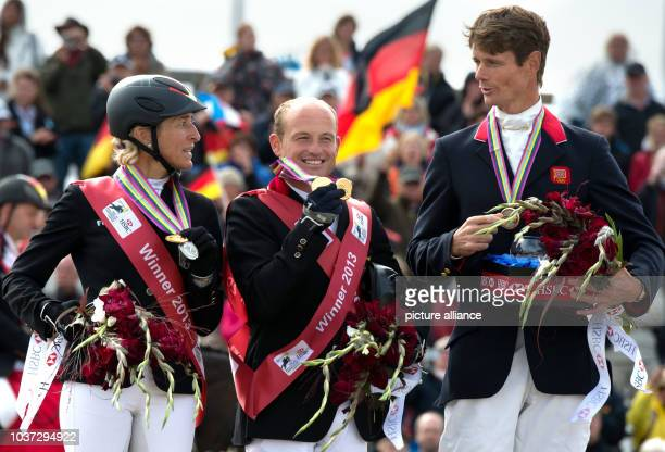 German eventers Ingrid Klimke and Michael Jung and British eventer William FoxPitt pose with their medals at the European Eventing Championships in...