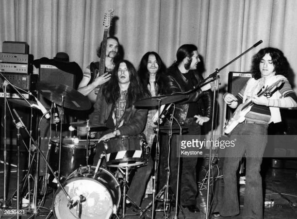German experimental rock group Can, from left to right; Holger Czukay, Michael Karoli, Damo Suzuki, Irmidt Schmidt and Jaki Leibzeit, during the...