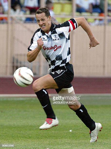 German F1 driver Michael Schumacher controls the ball, 18 May 2004 at the Louis II stadium in Monaco, prior the friendly football match between the...
