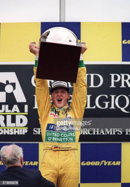 German F1 driver Michael Schumacher jubilates on the podium after winning his first Grand Prix AFP PHOTO/JEANLOUIS GAUTREAU/PASCAL PAVANI