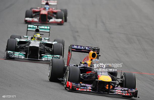 German F1 drivers Nico Rosberg of MercedesPetronas and Sebastian Vettel of Red Bull seen during of start of the Brazilian Formula one Grand Prix at...