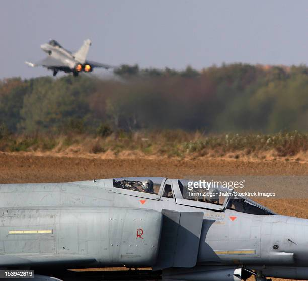 german f-4f phantom and a french rafale at nato's tactical leadership program exercise, florennes airfield, belgium. - dassault rafale stock pictures, royalty-free photos & images