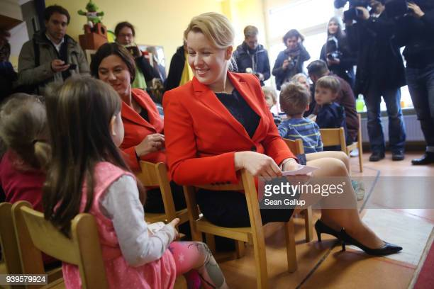 German Family Minister Franziska Giffey chats with children while visiting the Abenteuerland child daycare center on March 29 2018 in Berlin Germany...