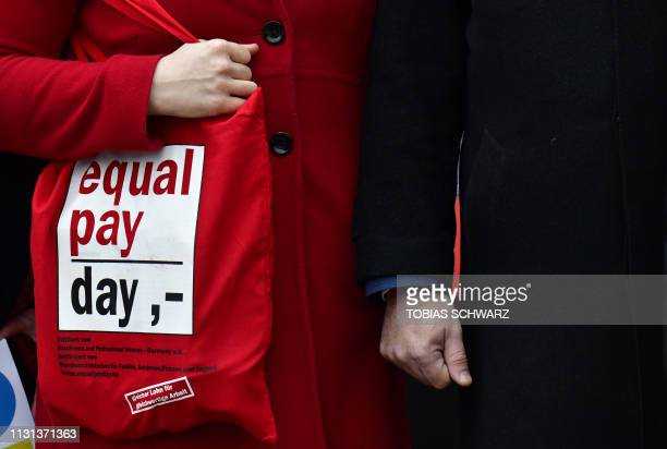 German Family Minister Franziska Giffey holds a bag advertising on the equal pay day as she attends a demonstration with German Labour Minister...