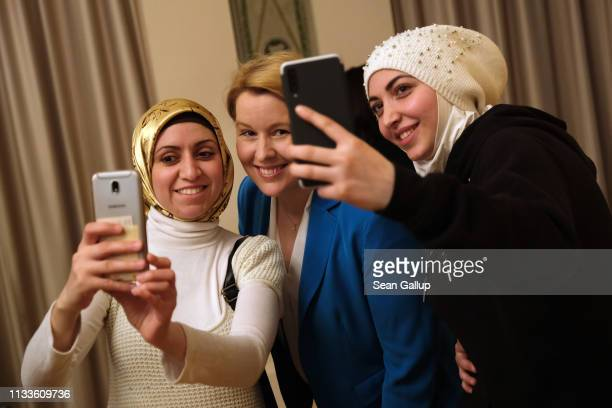 German Family Minister Franziska Giffey poses for selfies with Safaa Abou Zakou and Dema Abdullah who are both from Syria and are both participating...