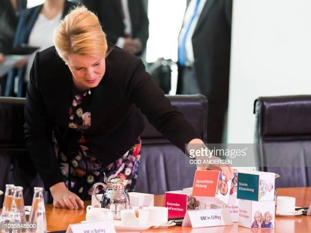 German Family Minister Franziska Giffey puts some promotional items from her ministry on the table prior to the weekly cabinet meeting at the...