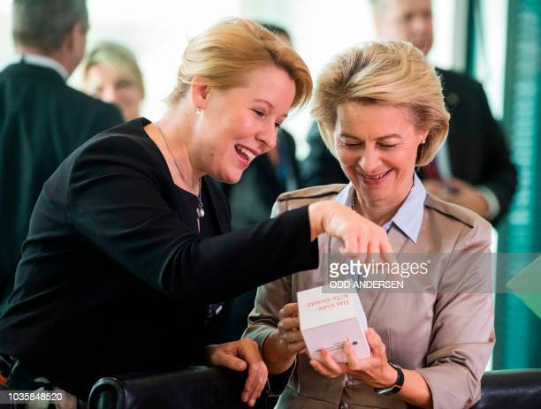 German Family Minister Franziska Giffey show German Defence Minister Ursula von der Leyen some promotional items from her ministry prior to the...