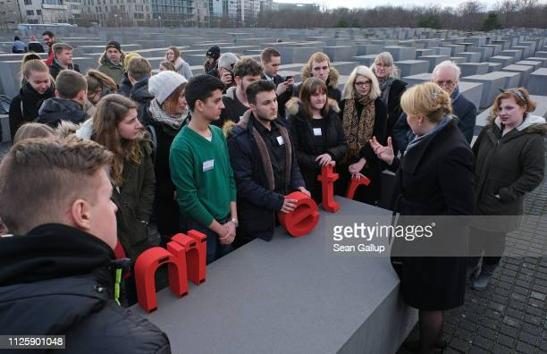 German Family Minister Franziska Giffey speaks with high school students who were visiting the Memorial to the Murdered Jews of Europe also called...