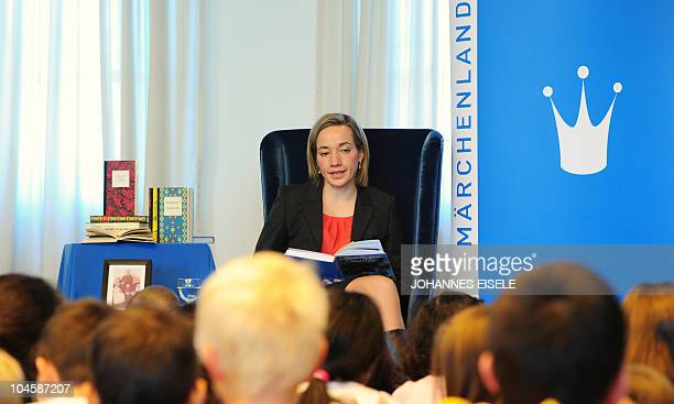 German Family Minister Kristina Schroeder reads a fairytale by Swedish writer Astrid Lindgren to children at the Max Liebermann House on October 1...