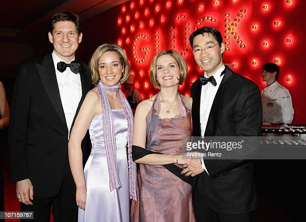 German Family Minister Kristina Schroeder with husband Ole Schroeder and German Health Minister Philipp Roesler with his wife Wiebke Roesler attend...